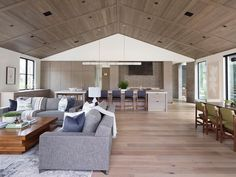 To complement the neutral color palette found throughout the interior of this modern farmhouse in California, the ceiling of the great room was lined with wood, adding warmth and a natural element. #WoodCeiling #ModernFarmhouse #GreatRoom