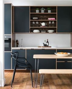 Dark green kitchen with wood details.