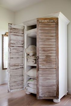 Create an armoire! Add 2 shutters to a bookcase, add door knobs. Love it! Perfect idea for a bathroom for towels or for a guest bedroom.