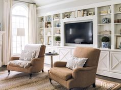 Contemporary White Seating Area with Custom Built-In Bookcase