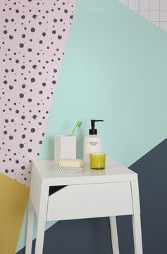Bring an 80s feel to your home with this funky wallpaper mural. Tying together beautifully block colours with abstract dots and grids. This design wallpaper will spruce up any wall in no time.