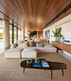 A modern living room with an expansive wood ceiling.