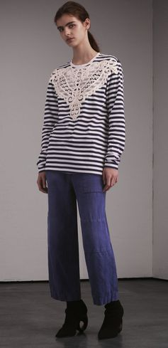 A unisex long-sleeved top made from Breton-striped cotton, in homage to the aprons worn by Henry Moore in his workshop. The intricate macramé lace appliqué is crafted at a storied Swiss mill.