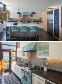 In this modern kitchen, a large white island provides space for three counter stools that complement the color of the light blue oven, while a chalkboard, dark counters, and back lighting provide a contrasting element. #WhiteKitchen #ModernKitchen