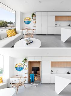 A Small Home Office Is Hidden Within These Minimalist White Kitchen Cabinets