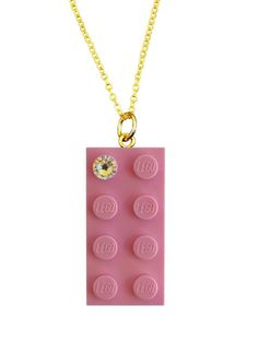Light Pink LEGO® brick 2x4 with a 'Diamond' color SWAROVSKI® crystal on a Silver/Gold plated trace chain (18 or 24) or on a 24 Pink ballchain* Selected and rare color of the LEGO® brick Length of the ballchain easily reducible * If you have a preference for the chain, dont forget to clarify it.