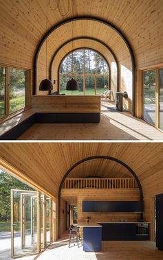 A Curved Corrugated Metal Roof Creates An Impressive Vaulted Ceiling Inside This Cabin
