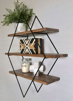 Wall Shelf Ideas - These modern geometric wall shelves, which have been designed in a variety of sizes and layouts, are made with steel frames, available in a variety of finishes, and are adorned with wood shelving to add a natural element. #WallShelf #WallDecor #ShelvingIdeas #ModernShelving #ModernShelf #Design