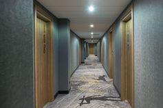In this contemporary and fun hotel, carpet with knights, scrolls and other motifs lead you to the rooms. #HotelDesign