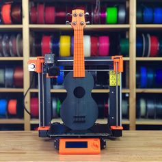 Ověřeno #prusament ukulele! And it is playable 🙂 Model by Ian Hanna. #ukulele #prusament #prusa #prusai3mk3 #mk3 #3dprinting #3dprinted #3dprinter #prusai3 #orange #prusai3 #toysandgames