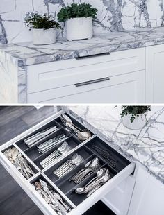This modern grey and white kitchen has a dedicated drawer just for formal cutlery, with designated sections for the different types. #KitchenDesign #KitchenIdeas #KitchenStorage #KitchenOrganization #KitchenDrawers #CutleryStorage