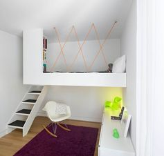 Kids Bedroom Ideas - This modern kid's bedroom has a custom loft bed with a built-in library, that allows the floor to be free to playing and reading. #KidsBedroomIdeas #BedroomIdeas #ModernBedroom