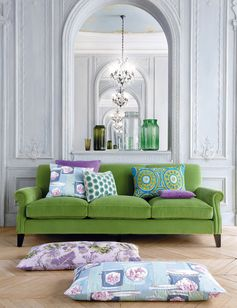 Green velvet looks so pretty with lilac and turquoise pillows