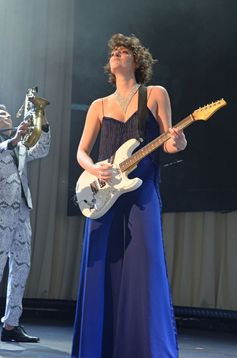 Phoebe Waller Bridge in a royal blue fringed cady jumpsuit by Stella McCartney