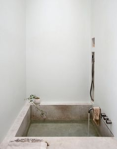Concrete bathtub in an alcove. Bathroom collection. Photo by Matthew Williams.