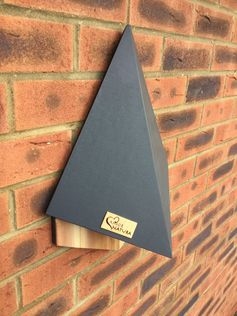 The 'Stealth' Bat House by AmorNatura, has a simple dark grey exterior, and a shape that that helps to deflect high winds. #BatHouse #BatBox