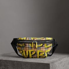 Large Graffiti Print Vintage Check and Leather Bum Bag by #Burberry - the 1990s streetwear staple revived in defaced Vintage check and leather