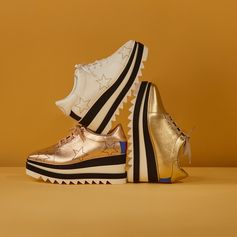 Getting kicks from the new #SneakElyse. Now in festive gold with a party-season star treatment...