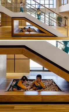 A Kids Play Area With A Ball Pit Was Designed For The Empty Space Under These Stairs