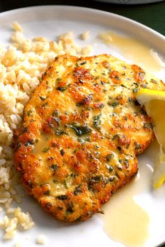 Once you've tried this tangy, yet delicate lemon chicken piccata, you won't hesitate to make it for company. Seasoned with parmesan and parsley, the chicken cooks up golden brown, then is drizzled with a light lemon sauce.