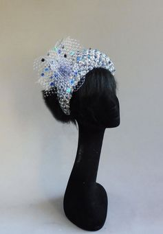 Handmade in Holland multiple shades of blue with off white bouclé fabric halo hat with ton sur ton birdcage veiling fabric