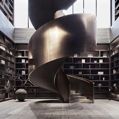 A large dark spiral staircase.