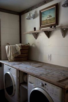 I like a more polished look, but the idea of a table or counter over the washer/dryer supported in the middle with shelves for laundry baskets is what I'm hoping to do for our laundry.