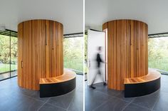 Tucked into one corner of this modern pool house, is a cylindrical bathroom with a wood bench wrapped around it on one side. Designed as a sculptural element within the pool house, the bathroom is clad in red cedar cleats, adding a sense of warmth to the open space that surrounds it. #Bathroom #RedCedar #RoundBathroom #CircularBathroom #PoolHouse