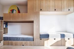 This Children's Bedroom Has A Bunk Bed Built For Three