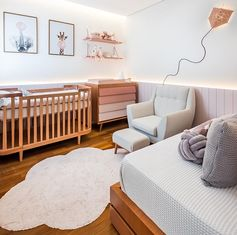 A palette of soft pinks and natural Jequitibá wood have been used throughout this modern nursery, while wood paneling with hidden indirect lighting helps to create a sense of warmth. #ModernNursery #PinkNursery #GirlsBedroom #InteriorDesign #Interiors #NurseryRoom #BabyRoom