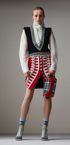 Ceremonial skirts styled with insignia meet soft-touch plastic layers