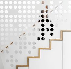 A Perforated Guardrail Screen Adds An Artistic Element To These Wood Stairs
