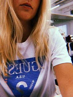 @kmfroelich on Instagram wearing the Men's Logo Tee. Our signature triangle logo sits front and center on this cotton short-sleeve tee with a crewneck. #LoveGUESS