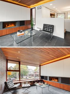 This modern living room has a wood ceiling, a fireplace, and views of the street. #LivingRoom #Fireplace