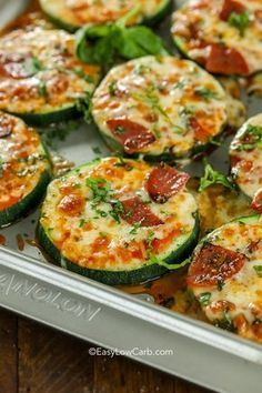 Zucchini Pizza Bites are one of our favorite snacks! These delicious pizza bites are topped with our favorite toppings and plenty of cheese for the perfect low carb pizza fix! #easylowcarb #keto #zucchini #zucchinipizzabites #zucchinipizza #pizzabites