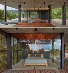 A glass enclosed bedroom.