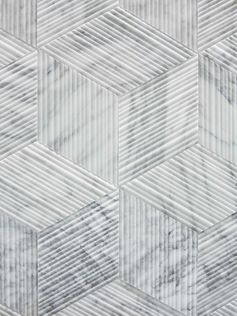 A grey bathroom tile with a textural bamboo-like finish.