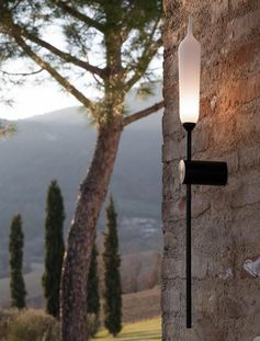 A modern outdoor wall lamp with a matte white resin diffuser and a black support.