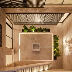 This internal courtyard has been designed with lighting embedded into the stone tiles, creating a soft glow that can be enjoyed at night. #OutdoorLighting #CourtyardLighting #EmbeddedLighting