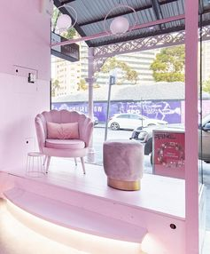 A modern monochromatic pink bakery interior draws inspiration from '70s California motel aesthetic. #PinkInterior #MonochromaticInterior #Bakery #RetailDesign #CafeDesign