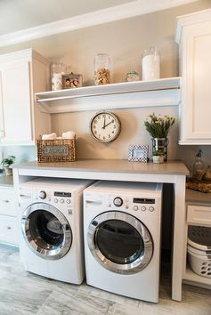 Laundry Room. Laundry Room. Laundry Room combines white cabinet with gray quartz countertop and porcelain floor tiles. Laundry Room Paint color is Sherwin Williams Silverplate. #LaundryRoom #LaundryRoomIdeas #LaundryRooms #LaundryRoomdesign Distinctive Remodeling Solutions, Inc Artisan Design Studio