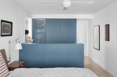 A Hidden Laundry Is Integrated Into The Closet Of This Master Bedroom