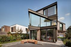 A modern house with angled middle floor.