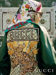 A leather jacket featuring an appliquéd dragon, from the Gucci-Dapper Dan collection, by the Harlem designer Dapper Dan and Alessandro Michele.
