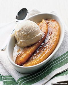 Bananas Foster:  1/2 c. (1 stick) unsalted butter; 1/2 c. packed light-brown sugar; 4 firm ripe bananas, peeled + halved lengthwise; 1/4 c. dark rum; Vanilla ice cream Melt butter with sugar over med.-high. Cook, swirling occasionally, until color deepens, about 3 min. Add bananas, cut sides down. Cook, swirling occasionally to make sure bananas are coated, 3 1/2 min. Flip bananas, + cook 2 1/2 min more. Remove pan from heat. Add rum. Return to med. heat, + cook about 10 secs