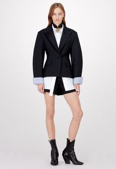 Louis Vuitton Cruise 2018 - Look 4 This look pairs a flattering waisted jacket with the collection's emblematic poplin shirt to create one of its statement silhouettes. Shorts in shiny silk wool radzimir provide a shiny/matte contrast: another key signature this season.
