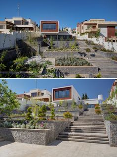 A terraced yard with wide stairs, small gardens, and places for relaxing.