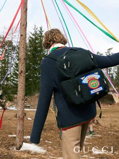 Crafted in black nylon, the techpack is equipped with multiple pockets and decorated with a rainbow terrycloth Gucci patch that is reminiscent of the '80s. Reworked within the Fall Winter 2018 eclectic narrative, the functional backpack is presented in unexpected materials and enriched with new motifs.