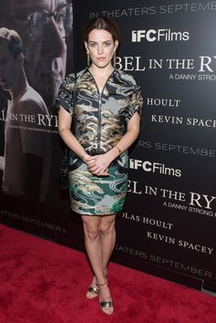 """Riley Keough wearing a look from the Louis Vuitton Cruise 2018 Collection by Nicolas Ghesquière to the """"Rebel in the Rye"""" Premiere in New York."""