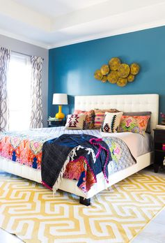 Love this colorful boho chic master bedroom design!